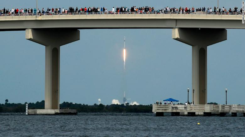 Spectators watch the SpaceX launch from a bridge in Titusville, Florida, on Saturday, May 30. The SpaceX Falcon 9 rocket with the Crew Dragon capsule is carrying astronauts Douglas Hurley and Robert Behnken toward the International Space Station.