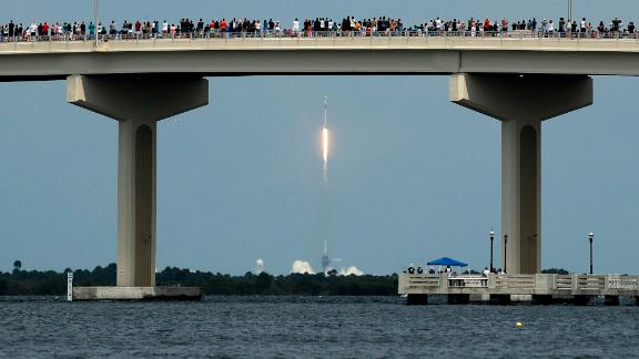 Spectators watch the SpaceX launch from a bridge in Titusville, Florida, on May 30.