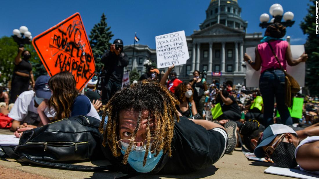 Thousands of people stage a die-in at the Colorado State Capitol on Saturday in Denver.