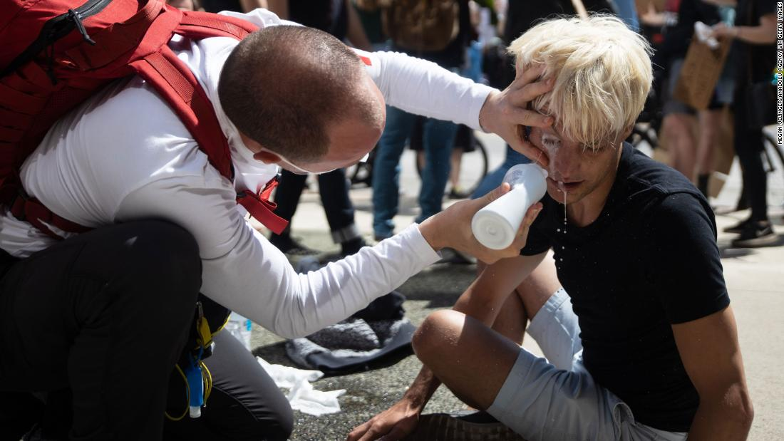 A protester receives first aid after being sprayed with pepper spray by police outside the state house in Columbus, Ohio, on Saturday.