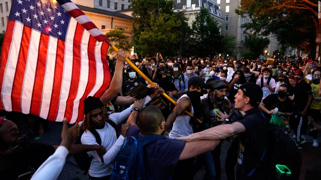 Demonstrators clash as people gather to protest the death of George Floyd, on Saturday, May 30, near the White House in Washington.