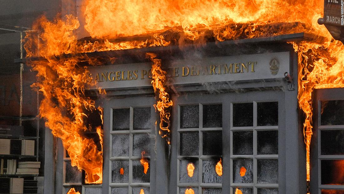 A Los Angeles Police Department kiosk burns in The Grove shopping center during a protest in Los Angeles on May 30.