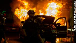 Peaceful protesters and violent instigators defy curfews after George Floyd's death
