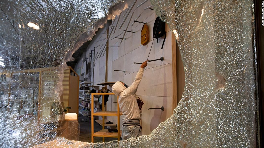 Looters ransack an Urban Outfitters store on May 30 in Seattle.