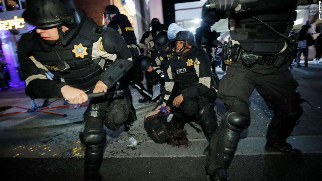 Police push people back as they detain a protester in Las Vegas on May 30.
