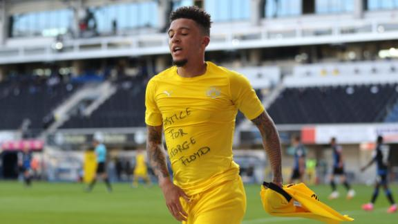 Jadon Sancho of Borussia Dortmund celebrates scoring his team's second goal of the game with a 'Justice for George Floyd' t-shirt during 6-1 Bundesliga win over SC Paderborn.