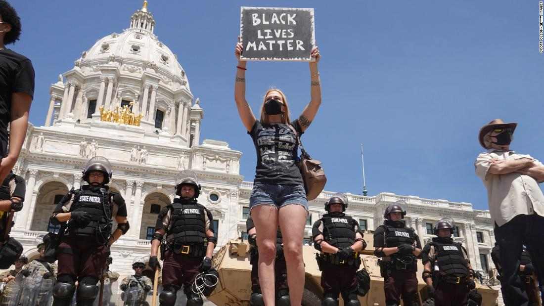 Demonstrators at a protest outside the Minnesota Capitol ringed with state troopers and National Guard soldiers in St. Paul on May 31.