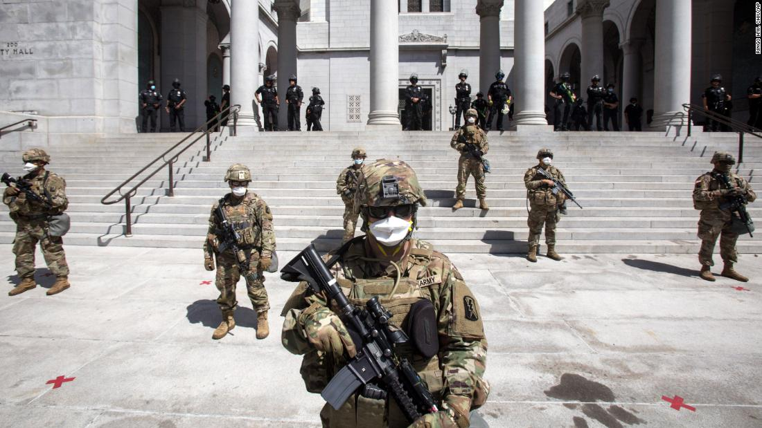 Members of the California Army National Guard stand guard outside of City Hall on May 31 in Los Angeles.