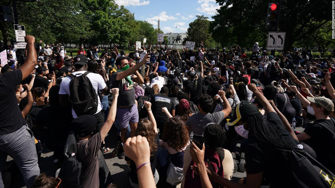 Demonstrators gather to protest near the White House in Washington, DC, on Sunday, May 31.