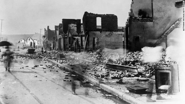 An image shows the aftermath of the white mobs that attacked black residents and businesses of the Greenwood District in Tulsa, Oklahoma.