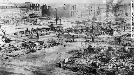 The picture shows the consequences of a white mob attacking black residents and businesses in the Greenwood district of Tulsa, Oklahoma.