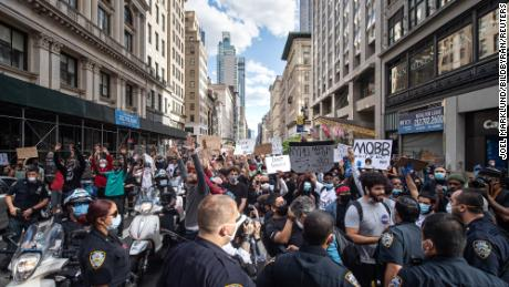 Demonstrators at 5th Avenue during a protest over the death of George Floyd, on May 31, 2020 in the Manhattan borough of New York.