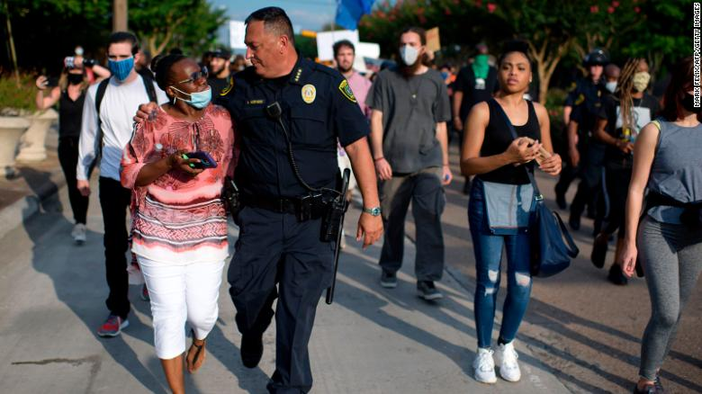 "Houston Police Chief Art Acevedo walked arm-in-arm with a woman during a ""Justice for George Floyd"" event Saturday."