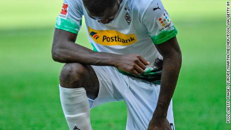 Borussia Mönchengladbach's Marcus Thuram Moenchengladbach's Marcus Thuram takes a knee after scoring Union Berlin at Borussia-Park on May 31, 2020.