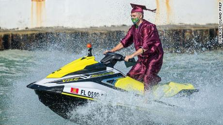 Seniors from Somerset Island Prep attended their graduation ceremony on jet skis.