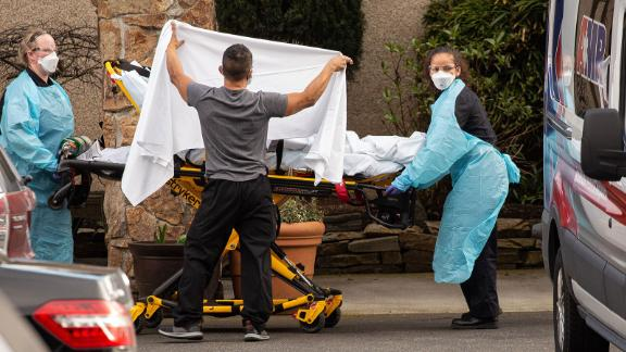 SEATTLE, WA - FEBRUARY 29: Healthcare workers transport a patient on a stretcher into an ambulance at Life Care Center of Kirkland on February 29, 2020 in Kirkland, Washington. Dozens of staff and residents at Life Care Center of Kirkland are reportedly exhibiting coronavirus-like symptoms, with two confirmed cases of (COVID-19) associated with the nursing facility reported so far. (Photo by David Ryder/Getty Images)