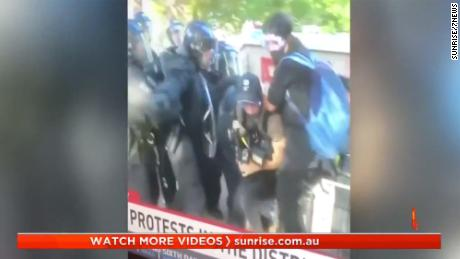 Australian journalists shown under attack by police.
