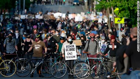 Protesters form a bicycle line as they protest the death of George Floyd in the Capitol Hill neighborhood of Seattle, Washington on June 1, 2020. - Major US cities -- convulsed by protests, clashes with police and looting since the death in Minneapolis police custody of George Floyd a week ago -- braced Monday for another night of unrest. More than 40 cities have imposed curfews after consecutive nights of tension that included looting and the trashing of parked cars. (Photo by Jason Redmond / AFP) (Photo by JASON REDMOND/AFP via Getty Images)