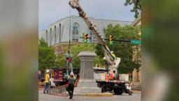A controversial Confederate statue with its back to the north was removed in historic Old Town Alexandria