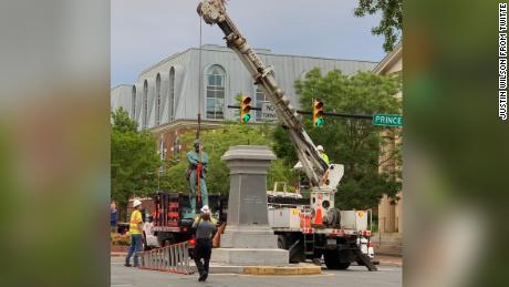 Crews in historic Old Town Alexandria are seen removing a bronze statue of a Confederate soldier.