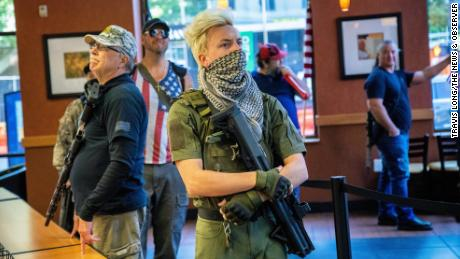 A group of about 11 mostly-armed demonstrators protesting the stay-at-home order marched around downtown Raleigh and ordered sandwiches at a Subway, Saturday morning, May 9, 2020.