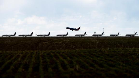 A Southwest Airlines flight takes off as United Airlines planes sit parked on a runway at Denver International Airport as the coronavirus pandemic slows air travel on April 22, 2020 in Denver, Colorado. Compared to the same time last year, Denver International Airport is operating 1,000 fewer flights daily. (Photo by Michael Ciaglo/Getty Images)