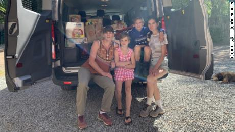 Jess Falkenhagen and a few helpers load a van before delivering supplies to the Navajo reservation in Window Rock, Arizona.