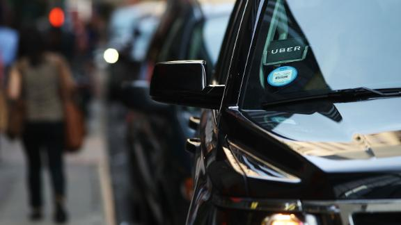 An Uber SUV waits for a client in Manhattan a day after it was announced that Uber co-founder Travis Kalanick will take a leave of absence as chief executive on June 14, 2017 in New York City. The move came after former attorney general Eric H. Holder Jr. and his law firm, Covington & Burling, released 13 pages of recommendations compiled as part of an investigation of sexual harassment at the ride-hailing car service.