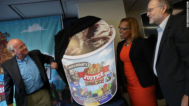 Ben & Jerry's co-founders Ben Cohen (L) and Jerry Greenfield (R) unveil Justice Remix'd during a press conference with Advancement Project executive director, Judith Dianis (C).
