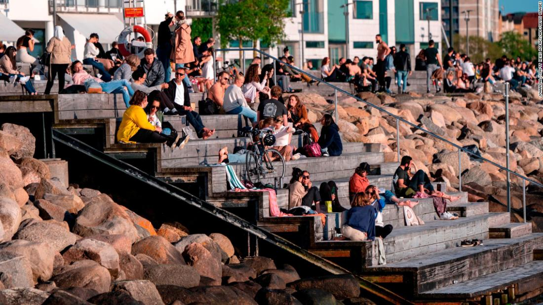 People enjoy socializing outdoors in Malmo, Sweden, on May 26