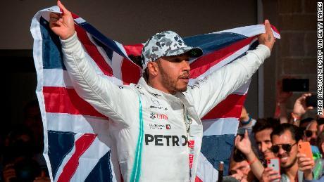 Hamilton celebrates winning last year's driver's championship.