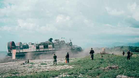 A US Navy landing craft brings US Marines ashore at the Naval Education Training Center, Philippines, during an amphibious offload in support of exercise KAMANDAG 3, Oct. 9, 2019.