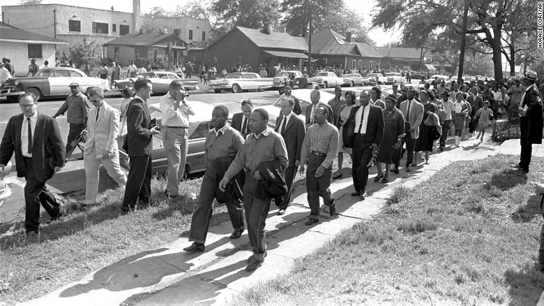 Rev. Ralph Abernathy and Rev. Martin Luther King Jr. lead a column of demonstrators as they attempt to march on Birmingham, Alabama, on April 12, 1963.