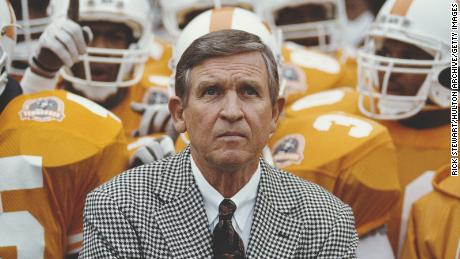 Majors is surrounded by members of the Tennessee Volunteers during a game against the University of Notre Dame in November 1990.