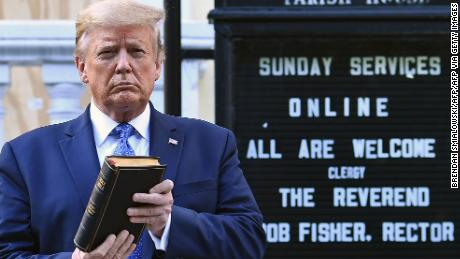 US President Donald Trump holds up a Bible outside of St John's Episcopal church across Lafayette Park in Washington.
