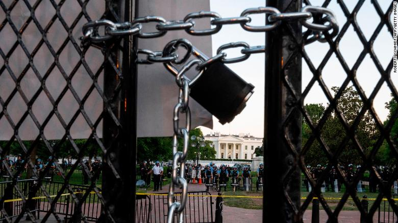 A locked padlock keeps a metal fence recently erected in front of the White House and meant to keep protestors at bay closed on June 2, 2020.