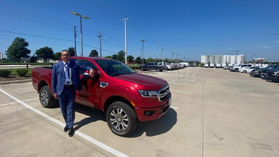 Brian Huth of Sam Pack's Five Star Ford in Texas stands next to one of the few Ford Rangers he has left to sell.