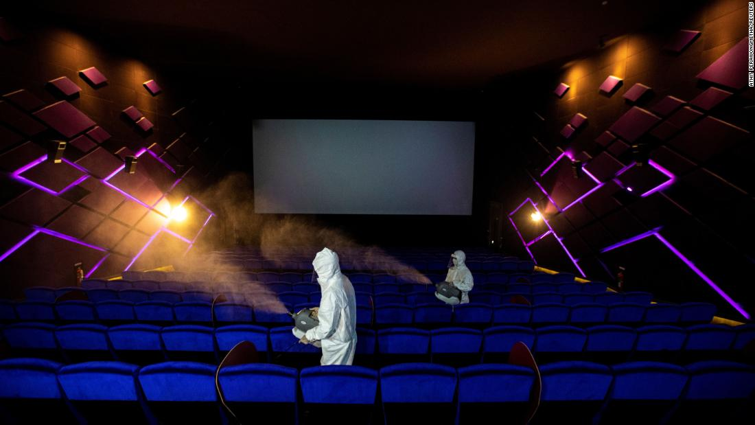 Workers spray disinfectant inside a movie theater in Bangkok, Thailand, ahead of its reopening on May 31.