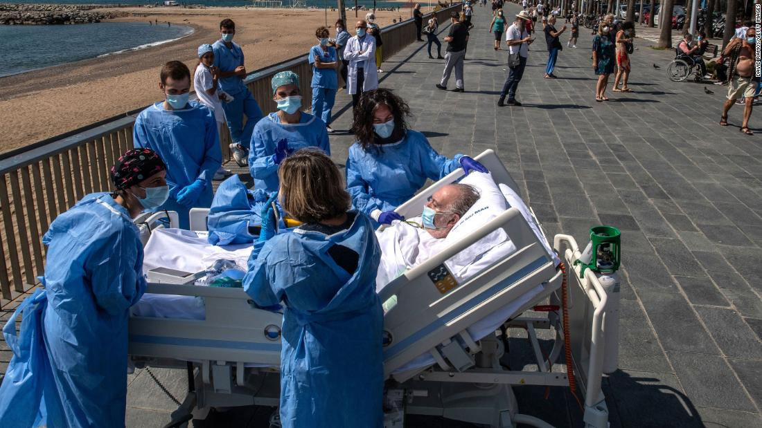 Isidre Correa, who is recovering from the coronavirus, is taken to the seaside in Barcelona, Spain, on June 3. Hospital del Mar has been taking patients to the seaside as part of the recovery process.