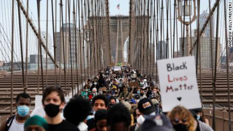 Demonstrators march across Brooklyn Bridge  on June 4, 2020