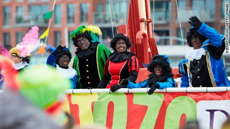 People dressed as Black Pete arrive by boat during the traditional St. Nicholas parade on November 16, 2019 in The Hague, Netherlands.