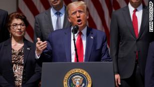 Trump invokes George Floyd's name while taking economic victory lap