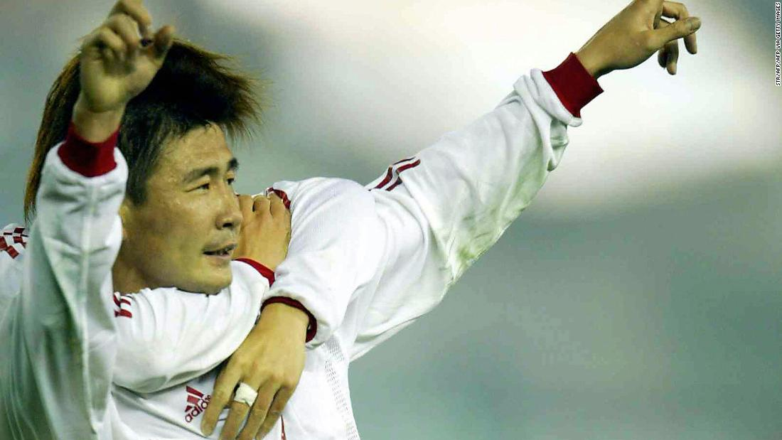 GUANGZHOU, CHINA:  China's Hao Haidong celebrates with an unseen teammate after scoring the only goal of the match, against Kuwait during a 2006 World Cup Asian Zone Group 4 qualifying match in Guangzhou, Southern China's Guangdong province, 18 February 2004.  China beat Kuwait 1-0. AFP PHOTO  (Photo credit should read STR/AFP via Getty Images)
