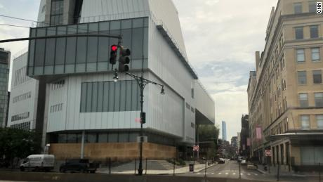 The Whitney Museum of American Art boarded up the floor-to-ceiling windows. The museum like others in New York City has been closed to patrons since March due to the pandemic.