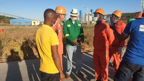 Mayor of Lusaka Miles Sampa asks staff at a Zambian cement factory about reports 100 Zambian workers have been prohibited from leaving the site during the Covid-19 pandemic.