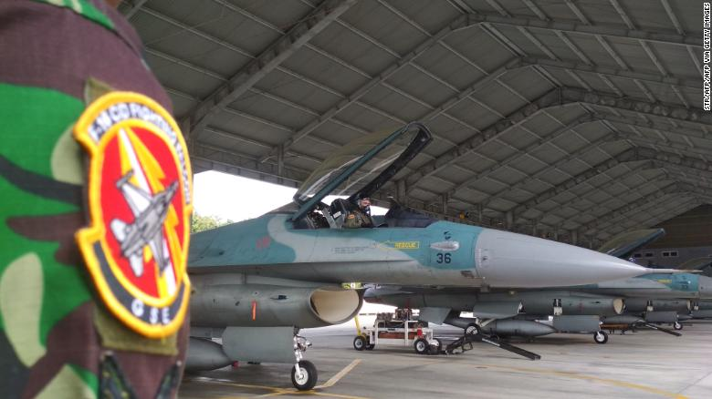 An Indonesian air force pilot prepares for taking off in an F-16 at an air base in Pekanbaru, Riau on January 7, to deploy near the Natuna Islands.