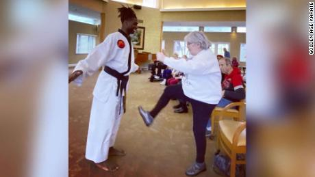 In a photo taken pre-social distancing, Wall teaches senior citizens karate as a way to keep healthy.