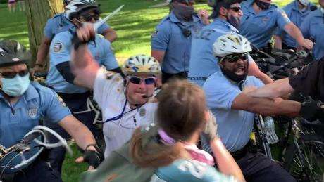 Philadelphia police inspector surrenders to face charges of assaulting student during protest