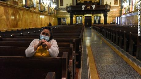 A person prays inside of St. Michael's Church on May 26, in the Brooklyn borough of New York City.
