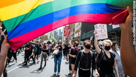 Protesters carry a Pride rainbow flag in New York city on Tuesday.